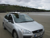 Rossnowlagh beach, car, and B&B in background